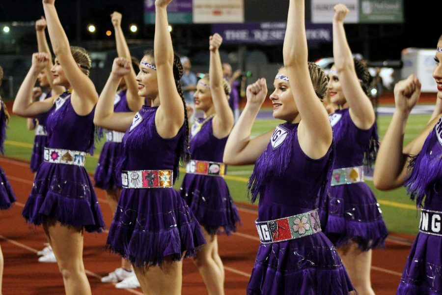 The+varsity+cheerleaders+perform+on+the+track+during+the+Indians+game+with+Huntsville+in+September.
