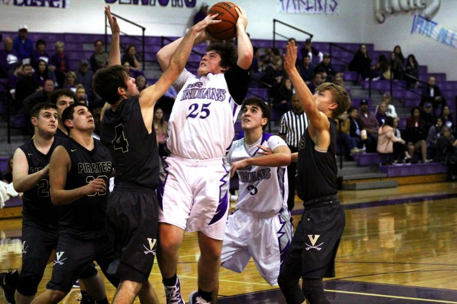 Senior Riley Abel fights to get a shot off in a lane crowded by Vidor defenders during their game earlier this season.