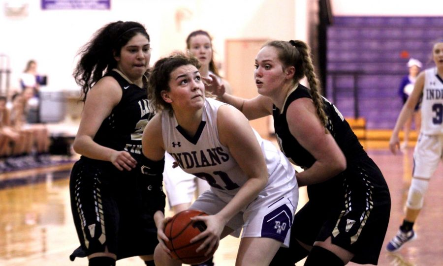 Senior Chelsea Carrillo battles the Vidor defense during last week's game at The Reservation.