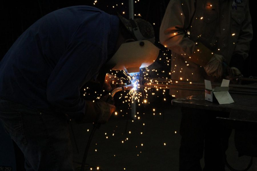 Students welding christmas trees for their christmas project.