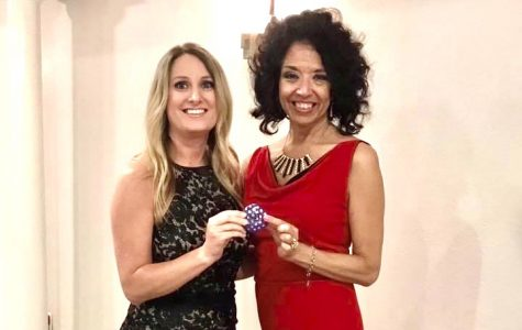 Mrs. Cortnie Schexnaider receives a PN-G rock from Mrs. Laura Solis during the Indianette banquet in early May. Schexnaider will be taking over as Indianette director after Solis announced she was stepping down in mid January.