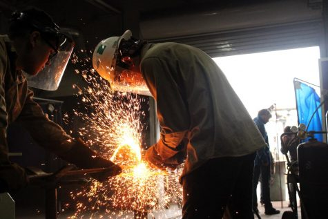 (Left) Carlos Uriostegui, and (Right) Eric Mendoza welding their christmas trees for their project.