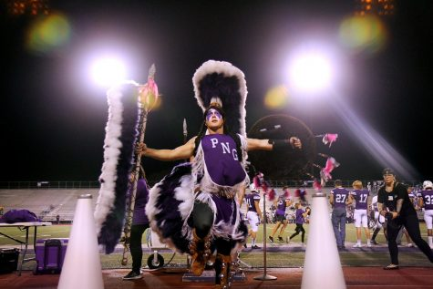 """Indian Spirit Jacob Smith, senior, dances to """"Cherokee"""" as halftime ends during the homecoming game with Baytown Lee on Friday, Sept. 27, 2019 at Indian Stadium."""