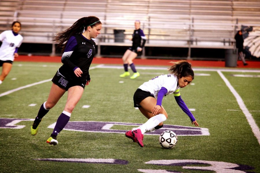 Varsity girls soccer player Halley Smith, left, moves in to win the ball against a Lufkin defender during the team's 2-0 win on Tuesday, Jan. 21, 2020 at Indian Stadium.