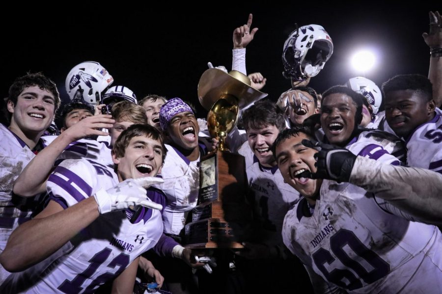The varsity football team celebrates with the Bum Phillips Trophy after winning the annual Mid-County Madness football game against Nederland, 27-21, on Friday, Nov. 8, 2019 at Bulldog Stadium.