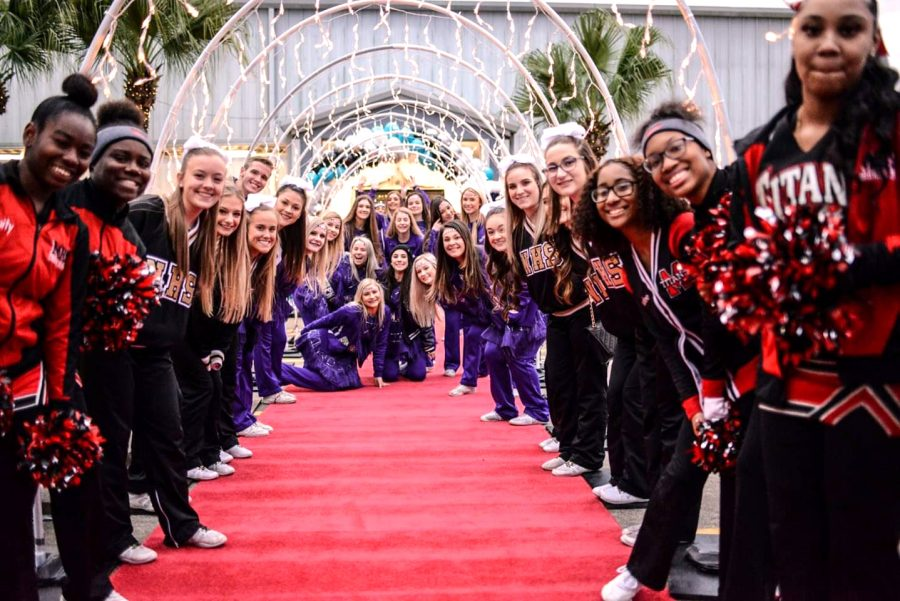 Cheer teams from PN-G, Nederland and Memorial high schools line the entrance to last year's Night To Shine prom, presented by the Tim Tebow Foundation.