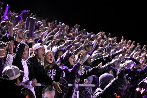 """The student section performs the """"War Chant"""" as the Indians cling to a six-point lead during the annual Mid-County Madness football game with Nederland on Friday, Nov. 8, 2019 at Bulldog Stadium. PN-G hung on to win, 27-21."""