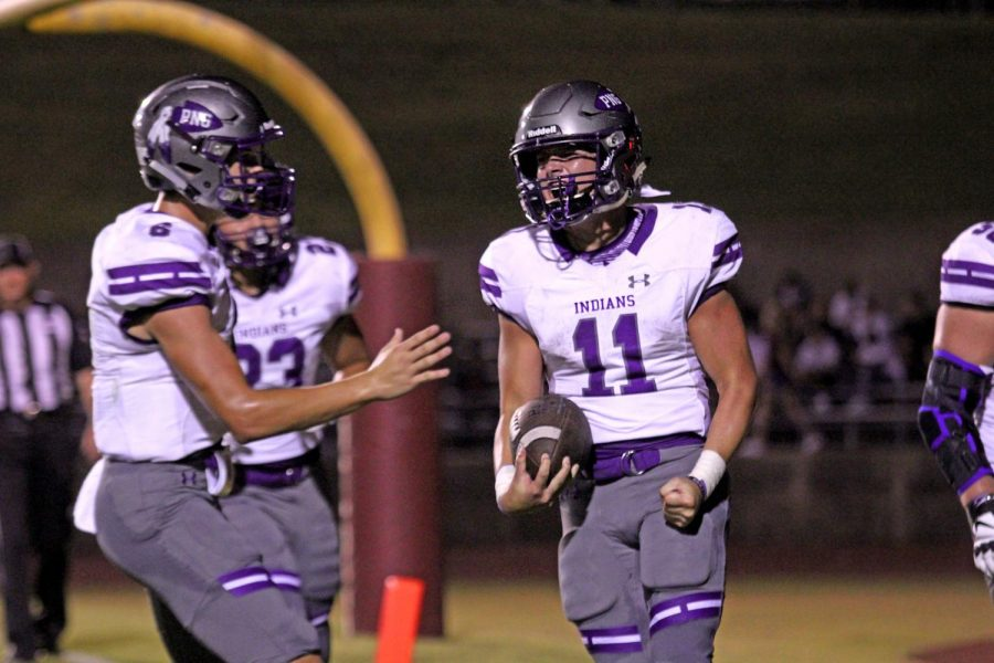 Running back Zane Hernandez, center, celebrates with the football after running for a first-half touchdown during the Indians' season-opening game at Silsbee on Friday, Aug. 30, 2019 at Tiger Stadium.