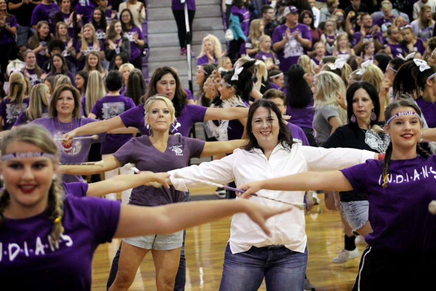 Past Frontline alumni perform with the varsity twirlers as other alumni perform with their various spirit teams during the homecoming pep rally on Friday, Sept. 27, 2019 in the competition gym.