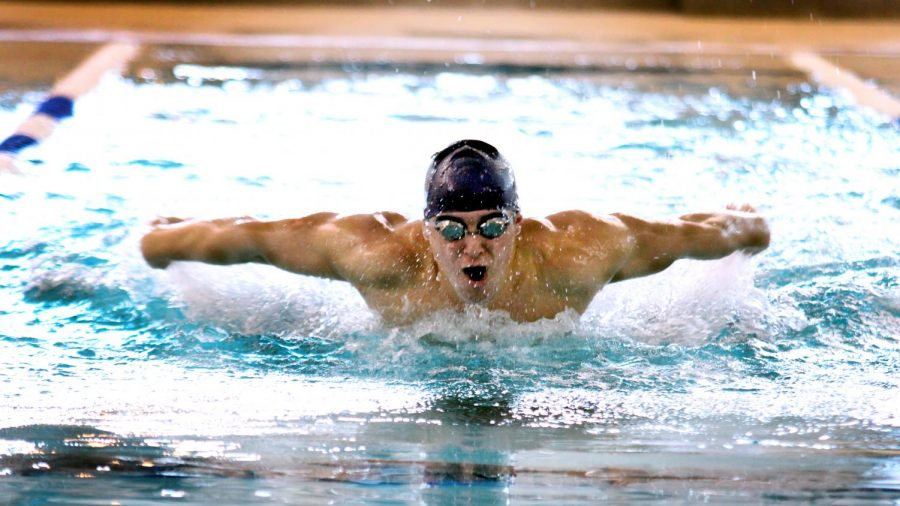 Varsity+swimmer+Jacob+Smith+moves+through+the+pool+during+his+50m+freestyle+heat+on+Saturday%2C+Jan.+25%2C+2020+at+the+Beaumont+ISD+Natatorium.+