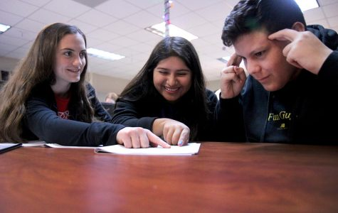 Seniors Britney Brevell, Stephanie Barron and Nathaniel Brant, junior, study and practice for their UIL Academic team.