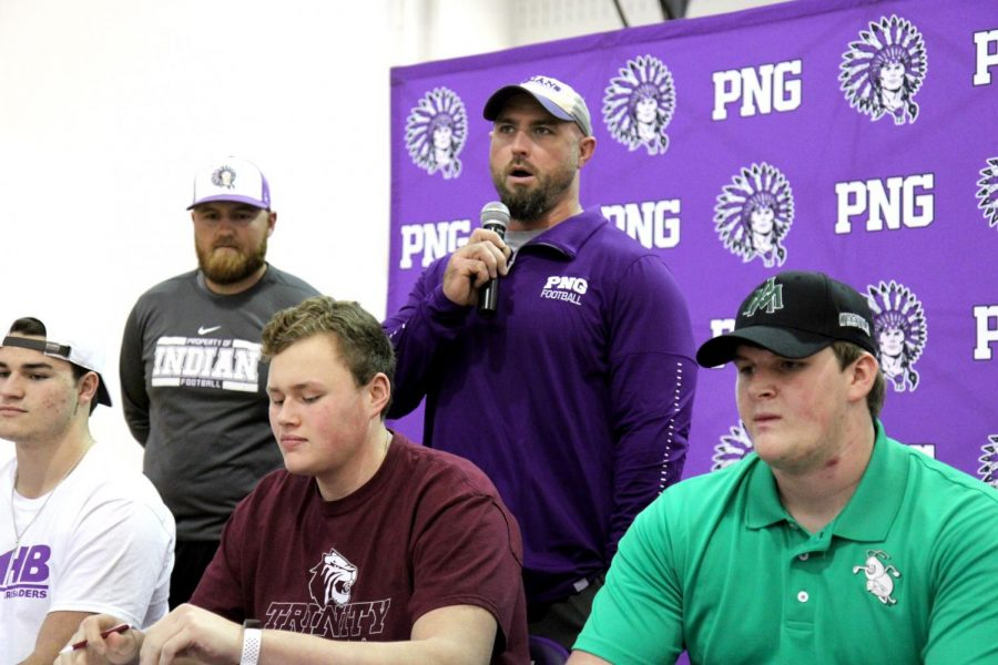Port Neches-Groves football player Trey Lisauckis listens as he's introduced by one of his coaches, Peter Medlock, during Wednesday afternoon's college signing ceremony in Port Neches.