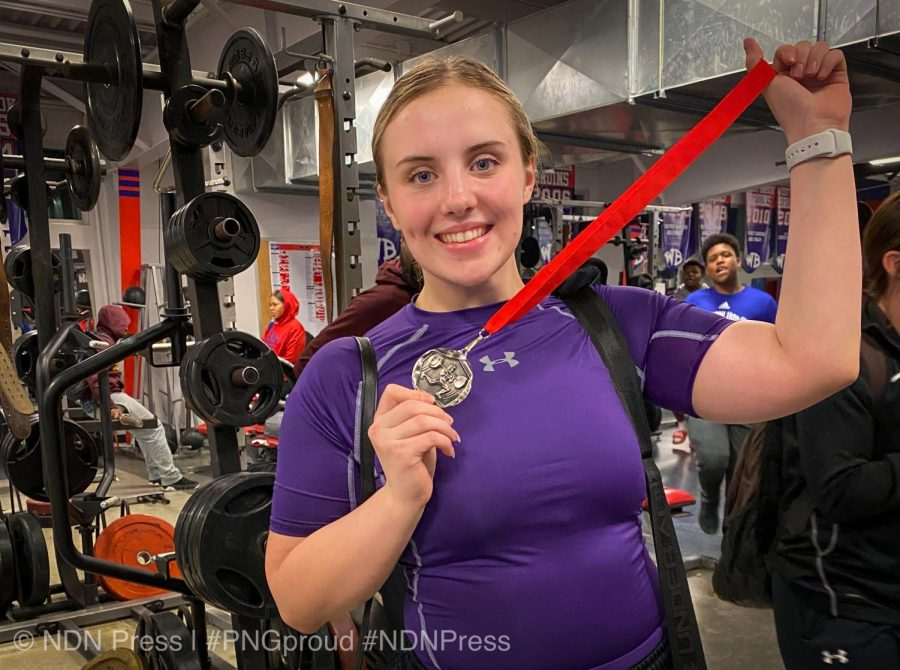 Gabbi Falgout holds her medal after placing second in the 181-pound class during Thursday's powerlifting meet at West Brook High School in Beaumont.