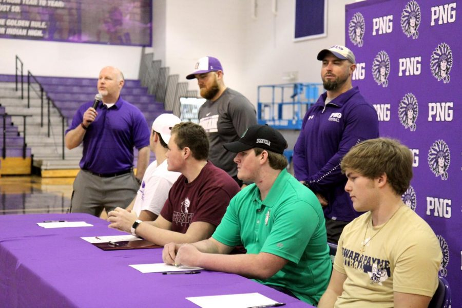Port Neches-Groves head coach Brandon Faircloth welcomes the crowd into the Indians' competition gym before the start of Wednesday afternoon's college signing ceremony in Port Neches.