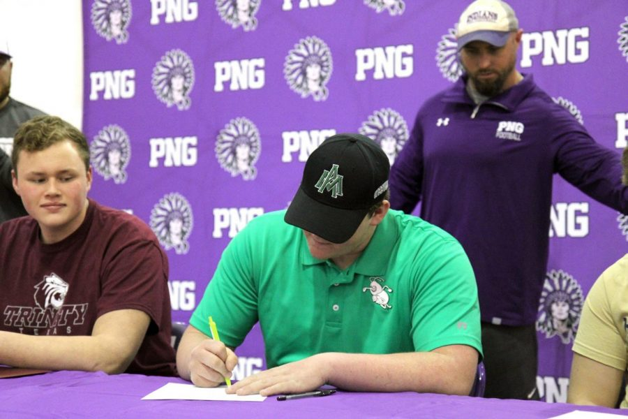 Port Neches-Groves football player Jarrett Callier signs with the University of Arkansas at Monticello during Wednesday afternoon's college signing ceremony in Port Neches.