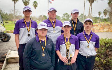 The JV boys golf team hold their trophy following their win in the Vidor JV Invitational.