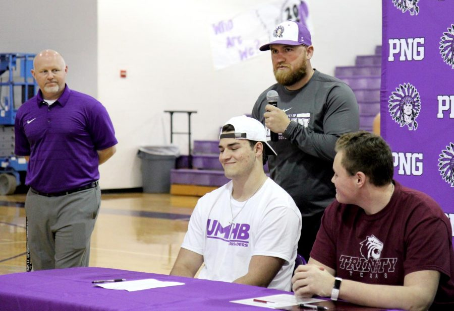 Port Neches-Groves football player Joshua Patteson listens as he's introduced by one of his coaches, Blake Austin, during Wednesday afternoon's college signing ceremony in Port Neches.