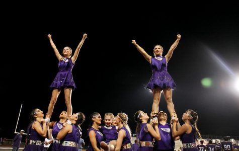 The varsity cheer team performs stunts during the Indians' home game with Dayton on Oct. 18, 2019.