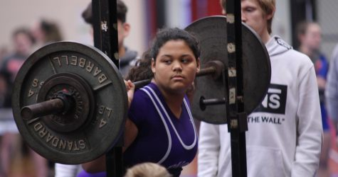 Nickole Wiltz, junior, lifts during the girls powerlifting team