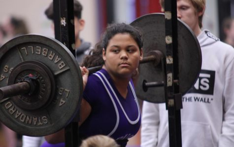 Nickole Wiltz, junior, lifts during the girls powerlifting team's meet last Thursday, Feb. 8, in Bridge City.