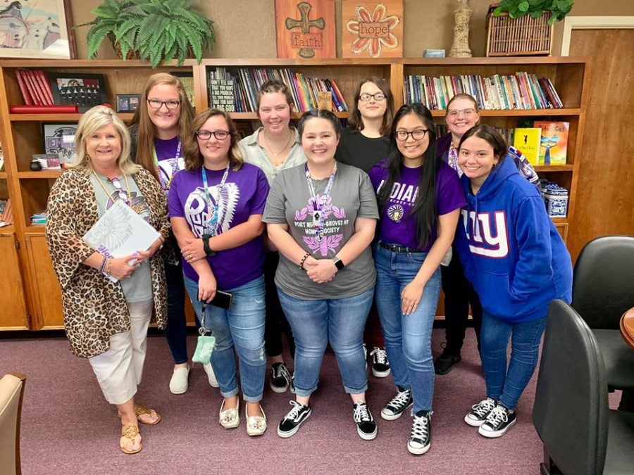 Asst. Superintendent Dr. Brenda Goates Duhon is presented with her copy of the recently published 2018-19 War Whoop yearbook on Sept. 14, 2019. Several of this year's staff are returning advanced journalism students. Some will help produce the book for the first time.