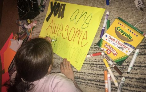 Groves Middle School 8th grader Brooklyn Jackson works on a 'positivity poster' activity for teacher Mrs. Kelsey Thibodeaux.