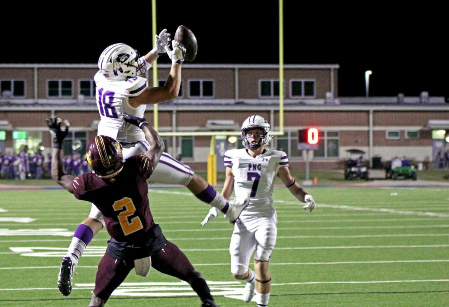 Varsity football player Ryan Sosa, senior, hauls in a pass from Brooks Barnwell during a misdirection play near the end zone against Beaumont United on Friday, Oct. 2. The play set up a score by Blake Bost to make it 26-14 just before halftime.