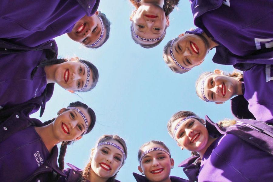 The varsity twirlers huddle up as they prepare for the Santa Fe pep rally on Friday, Dec. 4 at Indian Stadium. All pep rallies were held outside because of COVID-19 regulations this year.