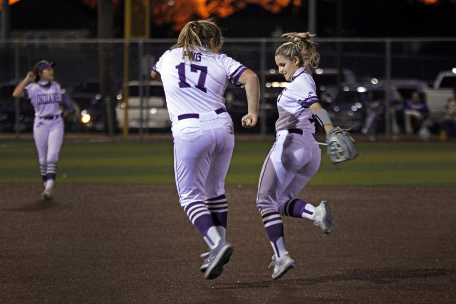 Varsity softball seniors Kilee Moody, left, and Lilly LeBlanc celebrate between outs during the team's 13-3 home win over Beaumont United on Tuesday, Oct. 23.