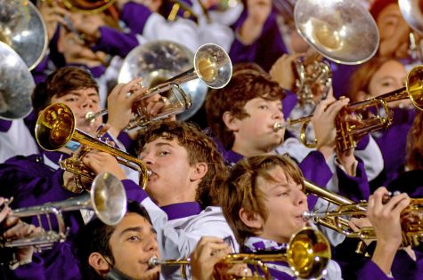 """The Purple Pride Band is captured in a moment when the brass section swayed back and forth during the fight song, """"Cherokee."""" The interspersed, directional weave created a strong criss-crossed, leading line composition."""