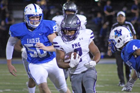 Running back Lance Vaughn, senior, carries the ball through the Barbers Hill defense as the Indians rumble toward the end zone in the second quarter of their game on Friday, Nov. 6 at Eagle Stadium in Mont Belvieu.