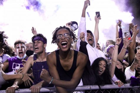 The student section erupts and the baby powder flies as the Indians score the go-ahead touchdown in the final seconds of the fourth quarter during the annual Mid-County Madness rivalry football game with the Nederland Bulldogs on Friday, Oct. 23 at Bulldog Stadium in Nederland.